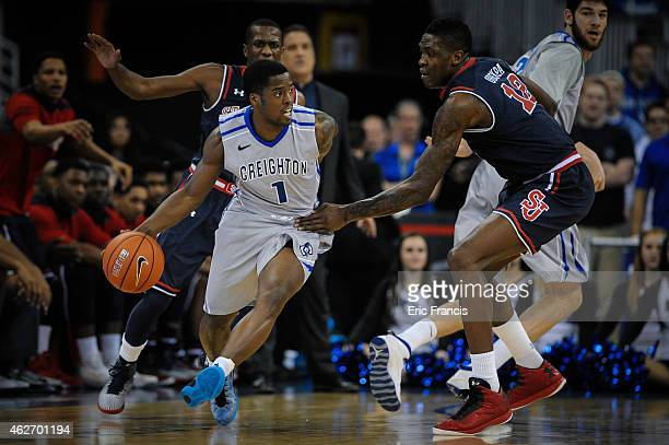 Austin Chatman of the Creighton Bluejays tries to move past Chris Obekpa of the St John's Red Storm during their game at CenturyLink Center January...