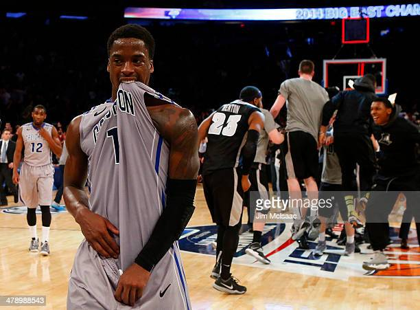Austin Chatman of the Creighton Bluejays walks off of the court dejected as the Providence Friars celebrate their 65 to 58 win in the Championship...