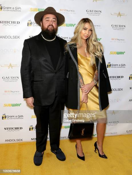 Austin Chumlee Russell from History's Pawn Stars television series and Olivia Rademann attends the Grant a Gift Autism Foundation's ninth annual...