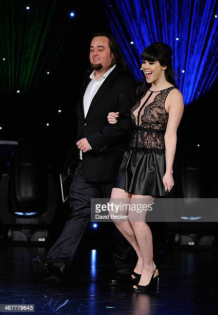 Austin 'Chumlee' Russell from History's 'Pawn Stars' television series and model Claire Sinclair present the Comeback of the Year award during the...
