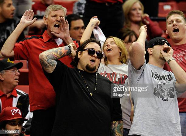 """Austin """"Chumlee"""" Russell from History's """"Pawn Stars"""" television series chants with UNLV Rebels fans as the team takes on the Wyoming Cowboys during a..."""