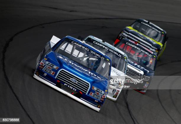 Austin Cindric driver of the DrawTite/Reese Brands Ford leads a pack of trucks during the NASCAR Camping World Truck Series LTi Printing 200 at...