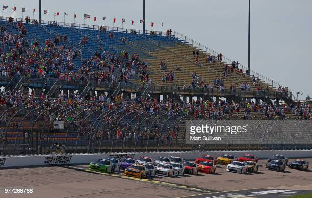 Austin Cindric driver of the Fitzgerald Glider Kits Ford and Daniel Hemric driver of the South Point Hotel Casino Chevrolet take the green flag to...