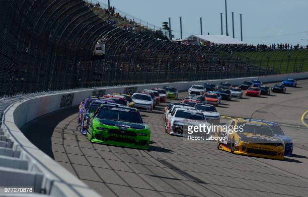 Austin Cindric driver of the Fitzgerald Glider Kits Ford and Daniel Hemric driver of the South Point Hotel Casino Chevrolet lead a pack of cars...