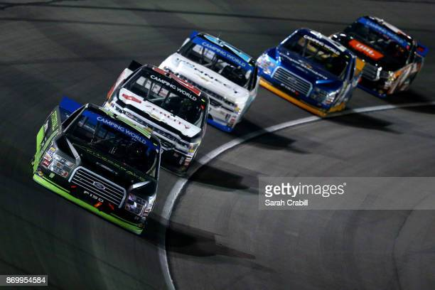 Austin Cindric driver of the Fitzgerald Glider Kits Ford leads a pack of trucks during the NASCAR Camping World Truck Series JAG Metals 350 Driving...