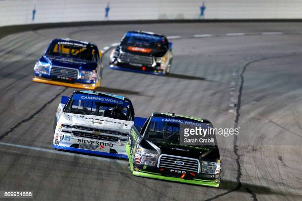 Austin Cindric driver of the Fitzgerald Glider Kits Ford leads Johnny Sauter driver of the ISMConnect Chevrolet during the NASCAR Camping World Truck...