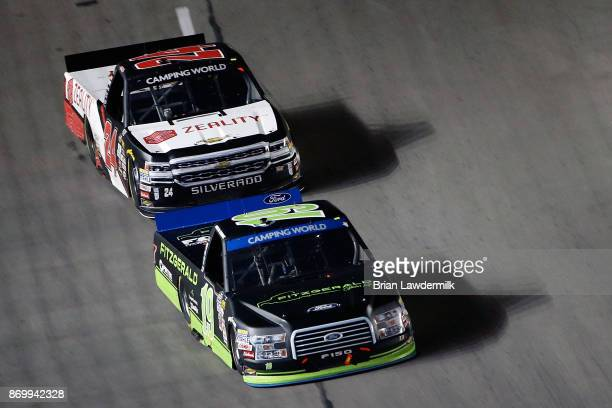 Austin Cindric driver of the Fitzgerald Glider Kits Ford leads Justin Haley driver of the Zeality Chevrolet during the NASCAR Camping World Truck...