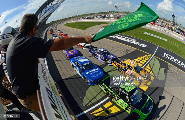 Austin Cindric driver of the Fitzgerald Glider Kits Ford takes the green flag to start the NASCAR Xfinity Series Iowa 250 presented by Enogen at Iowa...