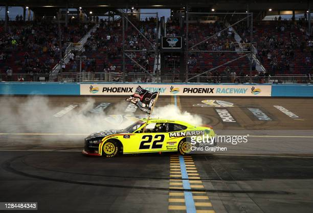 Austin Cindric, driver of the Menards/Richmond Ford, celebrates with a burnout after winning the NASCAR Xfinity Series Desert Diamond Casino West...