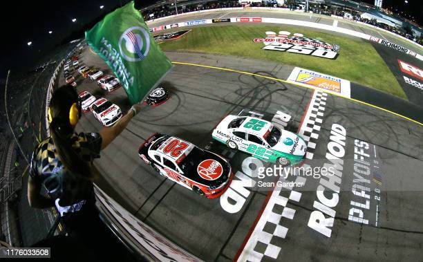 Austin Cindric driver of the MoneyLion Ford and Christopher Bell driver of the Rheem Toyota lead the field to the green flag start of the the NASCAR...