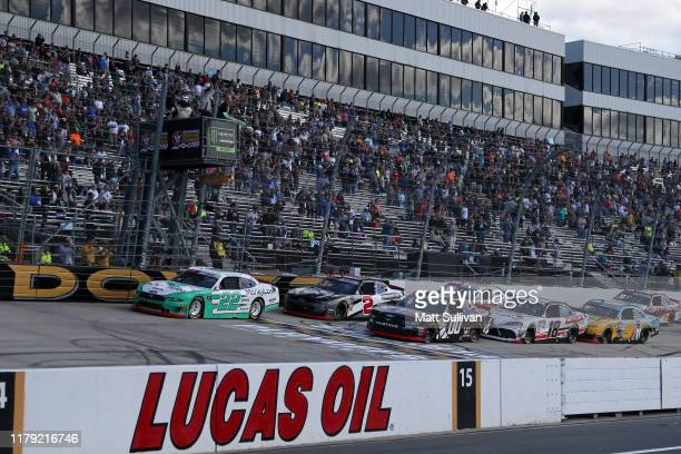 Austin Cindric driver of the MoneyLion Ford and Cole Custer driver of the Production Alliance Group Ford take the green flag to start the NASCAR...