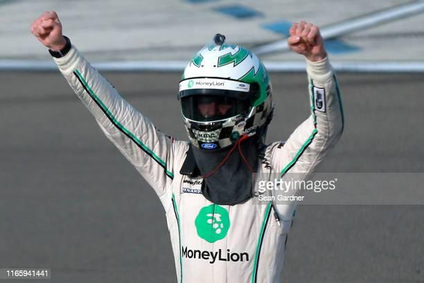 Austin Cindric, driver of the MoneyLion Ford, celebrates after winning the NASCAR Xfinity Series Zippo 200 at The Glen at Watkins Glen International...