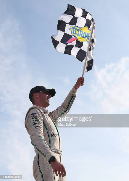 Austin Cindric, driver of the MoneyLion Ford, celebrates in Victory Lane after winning the NASCAR Xfinity Series Zippo 200 at The Glen at Watkins...