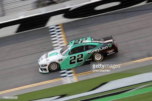 Austin Cindric, driver of the MoneyLion Ford, crosses the finish line winning the NASCAR Xfinity Series UNOH 188 at Daytona International Speedway on...