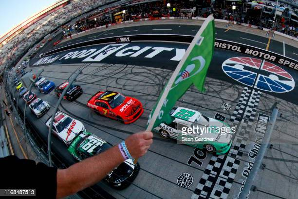 Austin Cindric, driver of the MoneyLion Ford, leads the field to the green flag to start the NASCAR Xfinity Series Food City 300 at Bristol Motor...