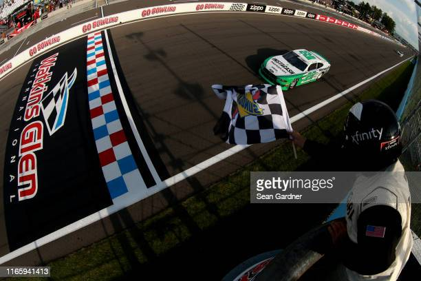 Austin Cindric, driver of the MoneyLion Ford, takes the checkered flag to win the NASCAR Xfinity Series Zippo 200 at The Glen at Watkins Glen...