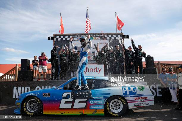 Austin Cindric driver of the PPG Ford celebrates after winning the BL Transport 170 at MidOhio Sports Car Course on August 10 2019 in Lexington Ohio