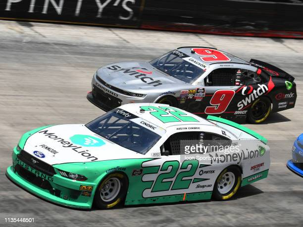 Austin Cindric Team Penske Ford Mustang MoneyLion races side by side with Noah Gragson JR Motorsports Chevrolet Camaro Switch during the Xfinity...
