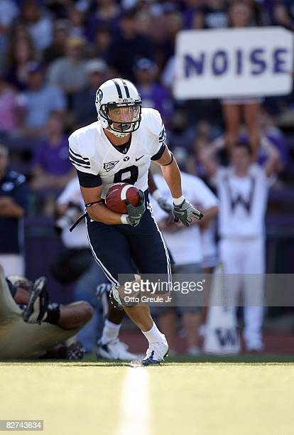 Austin Collie of the BYU Cougars runs with the ball during their game against the Washington Huskies on September 6, 2008 at Husky Stadium in...