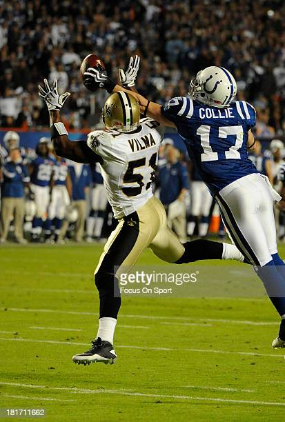 Austin Collie of the Indianapolis Colts can't make the catch defended by Jonathan Vilma of the New Orleans Saints during Super Bowl XLIV on February...