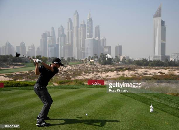 Austin Connelly of Canada hits his tee shot on the 8th hole during round two of the Omega Dubai Desert Classic at Emirates Golf Club on January 26...