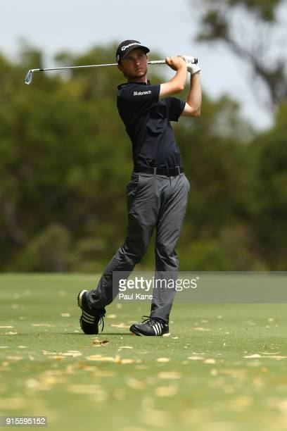 Austin Connelly of Canada watches his second shot on the 7th hole during day one of the World Super 6 at Lake Karrinyup Country Club on February 8...