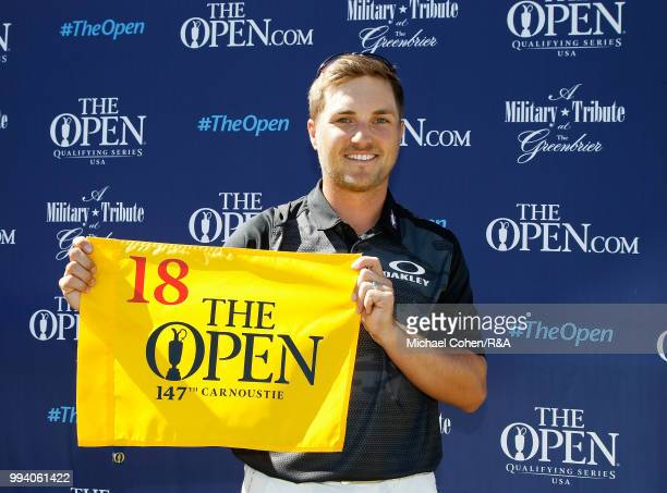Austin Cook of the United States holds a hole flag after qualifying for the Open Championship during the fourth and final round of A Military Tribute...
