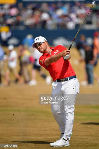 Austin Cook of the United States plays his second shot on the first hole during the final round of the 147th Open Championship at Carnoustie Golf...