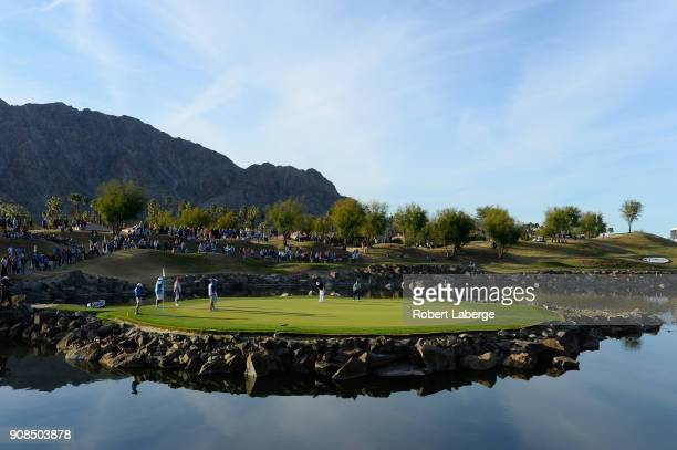 Austin Cook putts on the 17th hole as Andrew Landry looks on during the final round of the CareerBuilder Challenge at the TPC Stadium Course at PGA...
