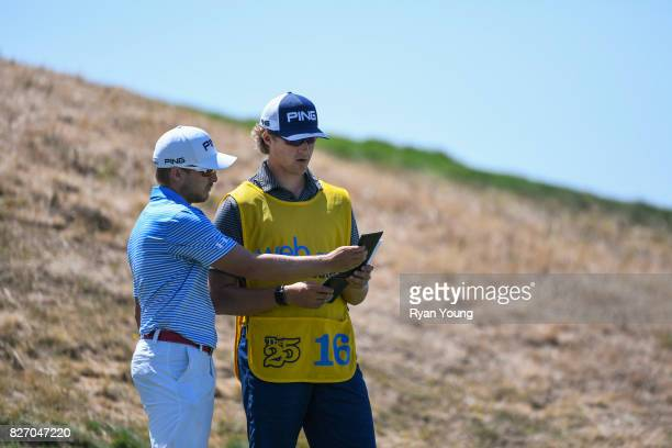 Austin Cook talks with his caddy on the second tee during the final round of the Webcom Tour Ellie Mae Classic at TPC Stonebrae on August 6 2017 in...