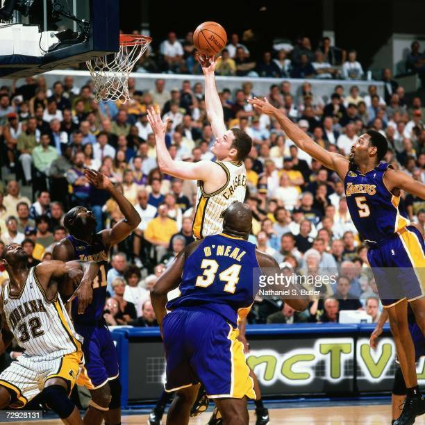Austin Croshere of the Indiana Pacers attempts a shot against Shaquille O'Neal of the Los Angeles Lakers during Game Four of the 2000 NBA Finals on...