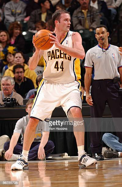 Austin Croshere of the Indiana Pacers looks to move the ball during a game against the New Jersey Nets at Conseco Fieldhouse on November 11, 2005 in...