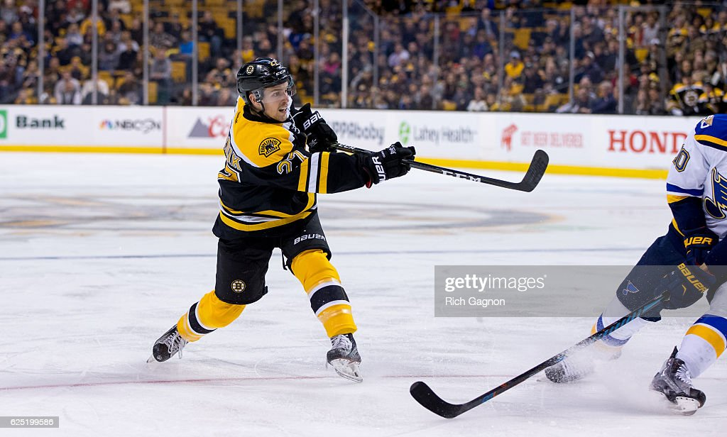 Austin Czarnik #27 of the Boston Bruins shoots the puck against the St. Louis Blues during the first period at TD Garden on November 22, 2016 in Boston, Massachusetts. The Blues won 4-2.