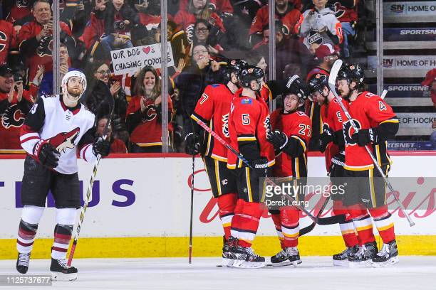 Austin Czarnik of the Calgary Flames celebrates with his teammates after scoring against the Arizona Coyotes during an NHL game at Scotiabank...
