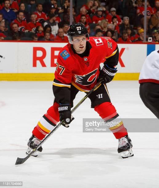 Austin Czarnik of the Calgary Flames face off against the Arizona Coyotes at Scotiabank Saddledome on February 18 2019 in Calgary Alberta Canada