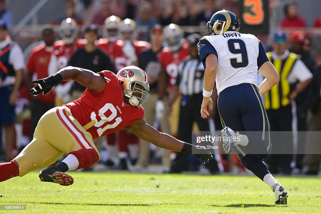 Austin Davis #9 of the St. Louis Rams is chased out of the pocket by Ray McDonald #91 of the San Francisco 49ers during the first quarter at Levi's Stadium on November 2, 2014 in Santa Clara, California.