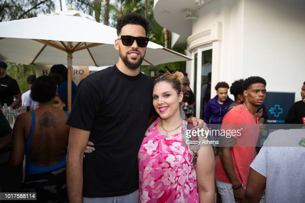 Austin Daye and Cassy Athena attend the Summertime Pool Party presented by Matt Barnes and Nick Cannon on August 11 2018 in Los Angeles California