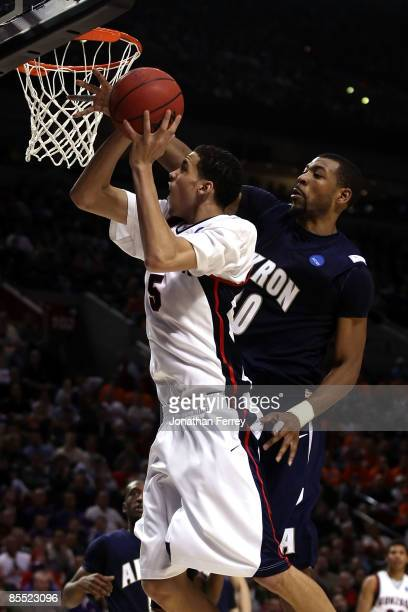 Austin Daye of the Gonzaga Bulldogs goes up for a shot against Chris McKnight of the Akron Zips in the second half during the first round of the NCAA...