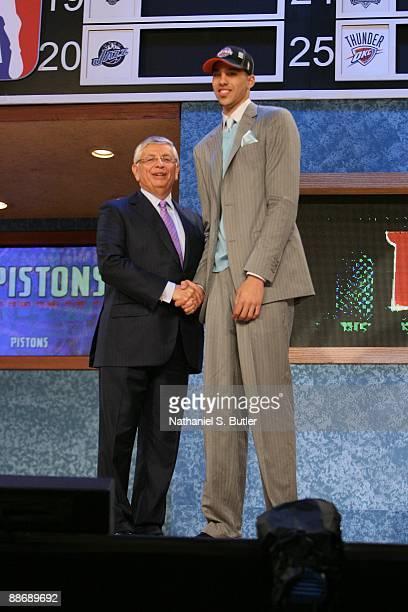 Austin Daye shakes hands with NBA Commissioner David Stern after being selected number fifteen by the Detroit Pistons during the 2009 NBA Draft on...