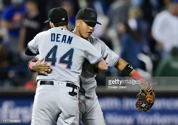 Austin Dean and Starlin Castro of the Miami Marlins hug after their 4-2 win over the New York Mets at Citi Field on September 26, 2019 in the...