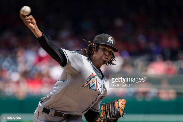 Austin Dean of the Miami Marlins hits an tworun double against the Washington Nationals during the third inning at Nationals Park on August 19 2018...