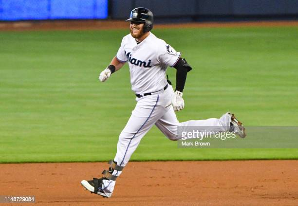 Austin Dean of the Miami Marlins rounds the bases after hitting a home run in the first inning against the Atlanta Braves at Marlins Park on June 9...