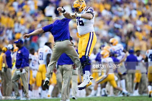 Austin Deculus and a assistant coach of the LSU Tigers celebrate af the end of the game against the Auburn Tigers at Tiger Stadium on October 14 2017...