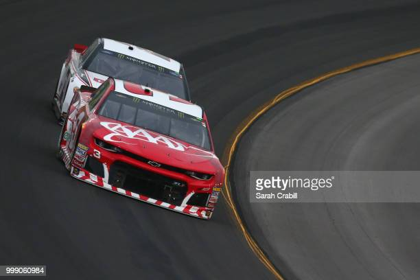 Austin Dillon driver of the AAA Chevrolet leads Brad Keselowski driver of the Discount Tire Ford during the Monster Energy NASCAR Cup Series Quaker...