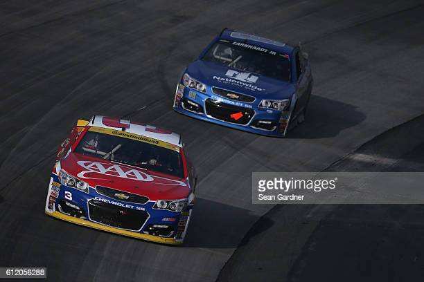 Austin Dillon, driver of the AAA Chevrolet, leads Jeff Gordon, driver of the Nationwide Chevrolet, during the NASCAR Sprint Cup Series Citizen...