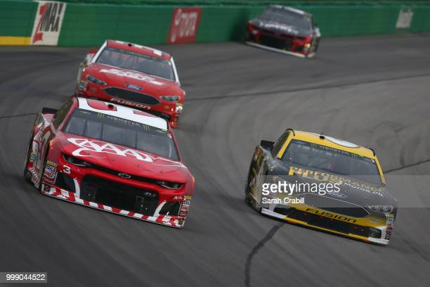 Austin Dillon driver of the AAA Chevrolet races Matt Kenseth driver of the Performance Plus Motor Oil Ford during the Monster Energy NASCAR Cup...