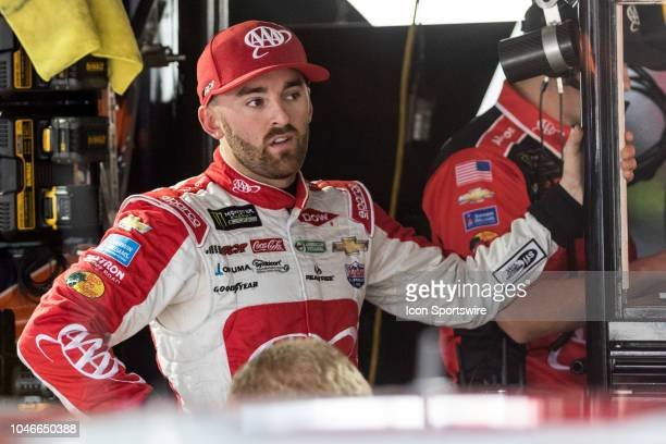 Austin Dillon driver of the AAA Chevrolet waits out the rain for Saturday's first practice session for the Gander Outdoors 400 on October 06 at Dover...
