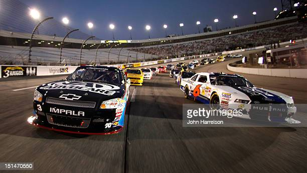 Austin Dillon, driver of the Advocare Chevrolet, and Ricky Stenhouse Jr., driver of the Ford EcoBoost Ford, lead the field before the start of the...