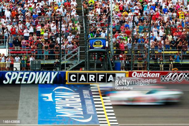 Austin Dillon, driver of the AdvoCare Chevrolet, leads Cole Whitt, driver of the Clean Coal Chevrolet, and the field to the green flag to start the...