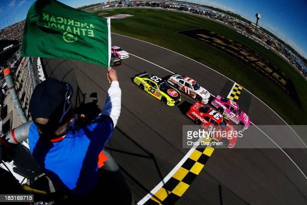 Austin Dillon, driver of the AdvoCare Spark Chevrolet, and Justin Allgaier, driver of the Brandt Chevrolet, lead the field past the green flag to...